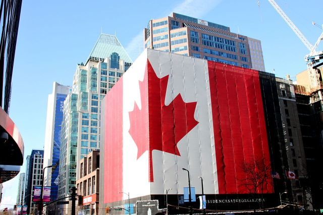1280px-Canadian_flag_on_building